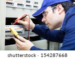 portrait of an electrician at... | Shutterstock . vector #154287668