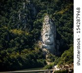 DJERDAP NATIONAL PARK, SERBIA - JULY 2013: The statue of Decebalus Rex, King of the Dacians on July 28, 2013 in Djerdap national park, Serbia. This is the tallest rock statue in Europe.