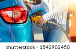 Small photo of Pumping gas at gas pump. Woman refuel the car. Woman at the petrol station. Woman filling her car with petrol at gas station. Pumping fuel in to the tank. Detail Of woman Filling Car With Diesel