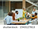 Small photo of Interior designers consider modern project in roomy design agency, caucasian blonde woman emotively shares paper instructions with coworker, dressed in casual outfit, pleasant atmosphere