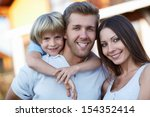 smiling family with child... | Shutterstock . vector #154352414