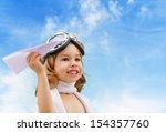 a child plays an airplane pilot | Shutterstock . vector #154357760