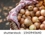 a basket of onion bulbs at a...