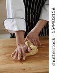 hands in flour closeup kneading ... | Shutterstock . vector #154403156