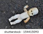 A Doll On The Beach.