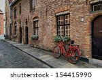 Red Bicycle Near The Window Of...