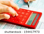 hands of accountant with... | Shutterstock . vector #154417973