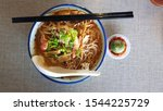 Small photo of Traditional Sarawak laksa is a famous Sarawak noodle dish which looks like the normal curry laksa. However, the Sarawak's version of this dish is slightly subtler compared to the normal curry laksa. I