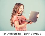 Happy Little Girl With Laptop....