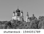 Black and white photo: view of the old St. Panteleimon Monastery in Feofania park. It was built in 1905-1912. Kiev, Ukraine, Europe. Autumn landscape, afternoon, religion and tourism.