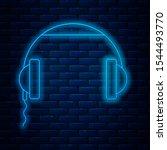 glowing neon line headphones... | Shutterstock .eps vector #1544493770