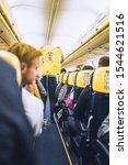 Small photo of Paris, France - October 06, 2019: A steward aboard a Ryanair airplane demonstrates how to use a life jacket before takeoff