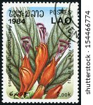 Small photo of LAOS - CIRCA 1984: post stamp printed in Laos shows image of Aeschynanthus speciosus (basket plant) from woodland flowers series, Scott catalog 556 A157 2k green red purple blue, circa 1984