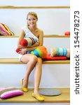 pretty woman sitting on white... | Shutterstock . vector #154478273