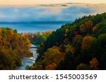 Taughannock Falls Gorge and Creek at Sunrise In Full Fall Colors On Foggy Day Overlooking Lower falls and Cayuga Lake