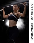 Small photo of Asian slim Fitness woman black hair sport bra exercise warm up on Pull up machine Weight Muscle Hands Arms bodybuilder in Fit Gym. Concept female Can Do athlete Sport healthy, back light bokeh