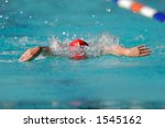 Boy swimming during a gala swimming event - stock photo