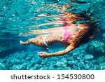 attractive young woman floating ... | Shutterstock . vector #154530800