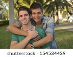 portrait of a happy gay couple... | Shutterstock . vector #154534439
