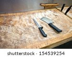 butcher knife on cutting board... | Shutterstock . vector #154539254