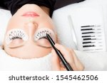 Small photo of Eyelash extension procedure. Master marker puts markup scheme guide lashes.