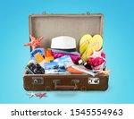 open suitcase with traveler's... | Shutterstock . vector #1545554963
