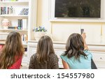 spending time on tv together at ... | Shutterstock . vector #154557980