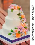 wedding cake decorated with... | Shutterstock . vector #154558634