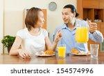 adult couple having breakfast... | Shutterstock . vector #154574996