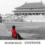 woman gazes across a courtyard... | Shutterstock . vector #154590458