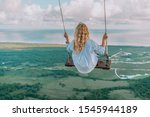 Small photo of Beautiful view of young woman swing on the top of the mountain Redonda in Dominican Republic. Concept travel, vacation
