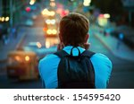 lonely guy sitting and looking... | Shutterstock . vector #154595420