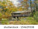 Covered Bridge And Autumn...