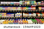 Small photo of Humble, Texas/USA 10/14/2019: Walmart shelves stocked with plastic juice bottles of various brands in the cooler section