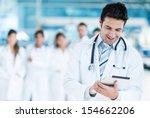 happy doctor using tablet... | Shutterstock . vector #154662206