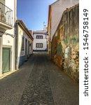 Small photo of Vila Nova de Mil Fontes, Alentejo, Portugal - September 07 2019: Small Street in Vila Nova de Mil Fontes