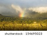 Landscape With Rainbow Near...