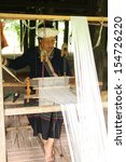Small photo of CHIANG MAI,THAILAND-SEPTEMBER 18 : Old Tai Lue woman while using cotton weaving apparatus., in Tai Lue's way of life2013 ,On September 18, 2013. in Chiang Mai, Thailand.