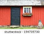 Front Of A Small Swedish Woode...