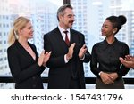 Small photo of Business people smile and applaud clap with success project team at modern bright office company concept with selective focus