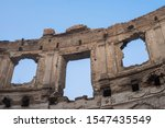 Small photo of Landscape of ruined buildings on the blue sky background , image of decrepitude or natural time disaster. The detail of old house sight