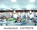 motion chefs of a restaurant... | Shutterstock . vector #154790378