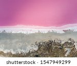 Small photo of Aerial high angle drone view of Loch Iel, also called Pink Lake, near the village of Dimboola in Victoria, Australia. The pink color results from red pigment secreted by microalgae in summer.