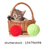 Stock photo cute kitten in a wicker basket with woolen balls isolated on white background 154796498