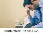 sad man sitting head in hands... | Shutterstock . vector #154811264