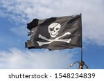 Jolly Roger Pirate Flag On Blu...