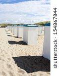 beach huts along the north sea... | Shutterstock . vector #154867844