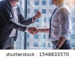 Small photo of Negotiating business concept.The boss congratulated his colleagues, shaking hands, willing to negotiate and recommend job.