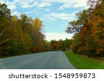 Striking fall foliage on the road near Wellesley Island State Park, New York,U.S.A