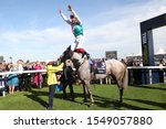 Small photo of DONCASTER RACECOURSE, STH YORKSHIRE, UK : 14 SEPTEMBER 2019 : Frankie Dettori executes a Flying Dismount from Logician after winning the 2019 running of the Group 1 St Leger at Doncaster Races